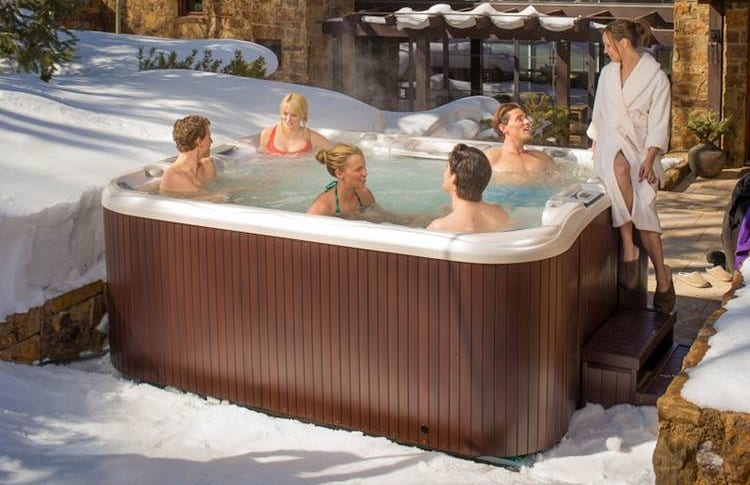 snow and outdoor hot tub