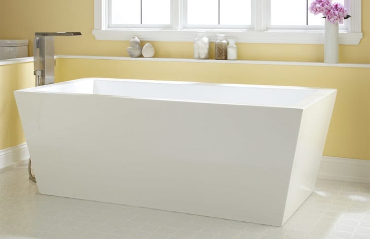 acrylic tub in yellow bathroom