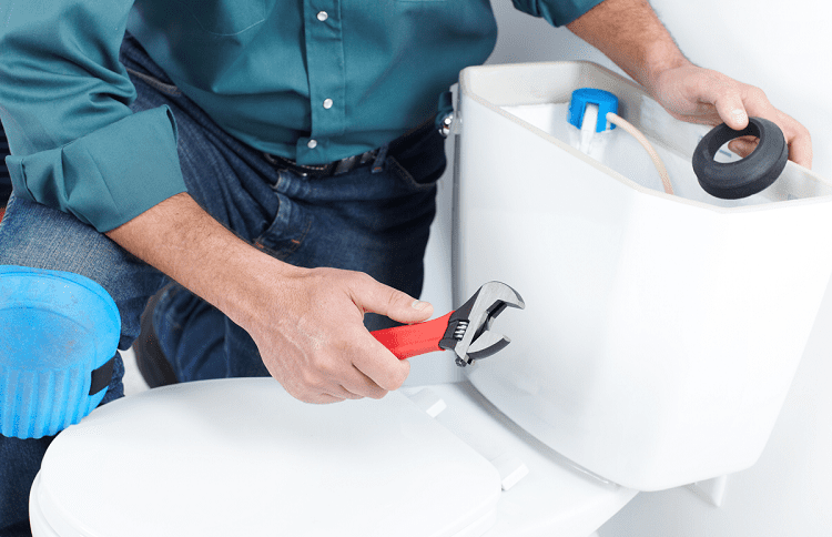 man fixing toilet valve